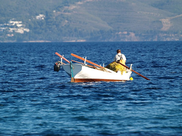 A greek fishing on a traditional boat
